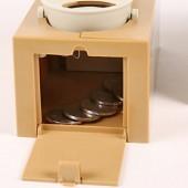 Psíkova pokladnička na drobné mince
