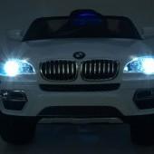 BMW X6 s 2,4G bluetooth DO, EVA kolesami, otváracími dverami, 12V, čalúnenú vyšívanou sedačkou, lakované