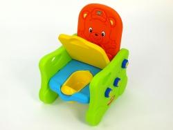 Kresielko s čalúneným sedákom, po odklopení sedadla s hracím nočníkom